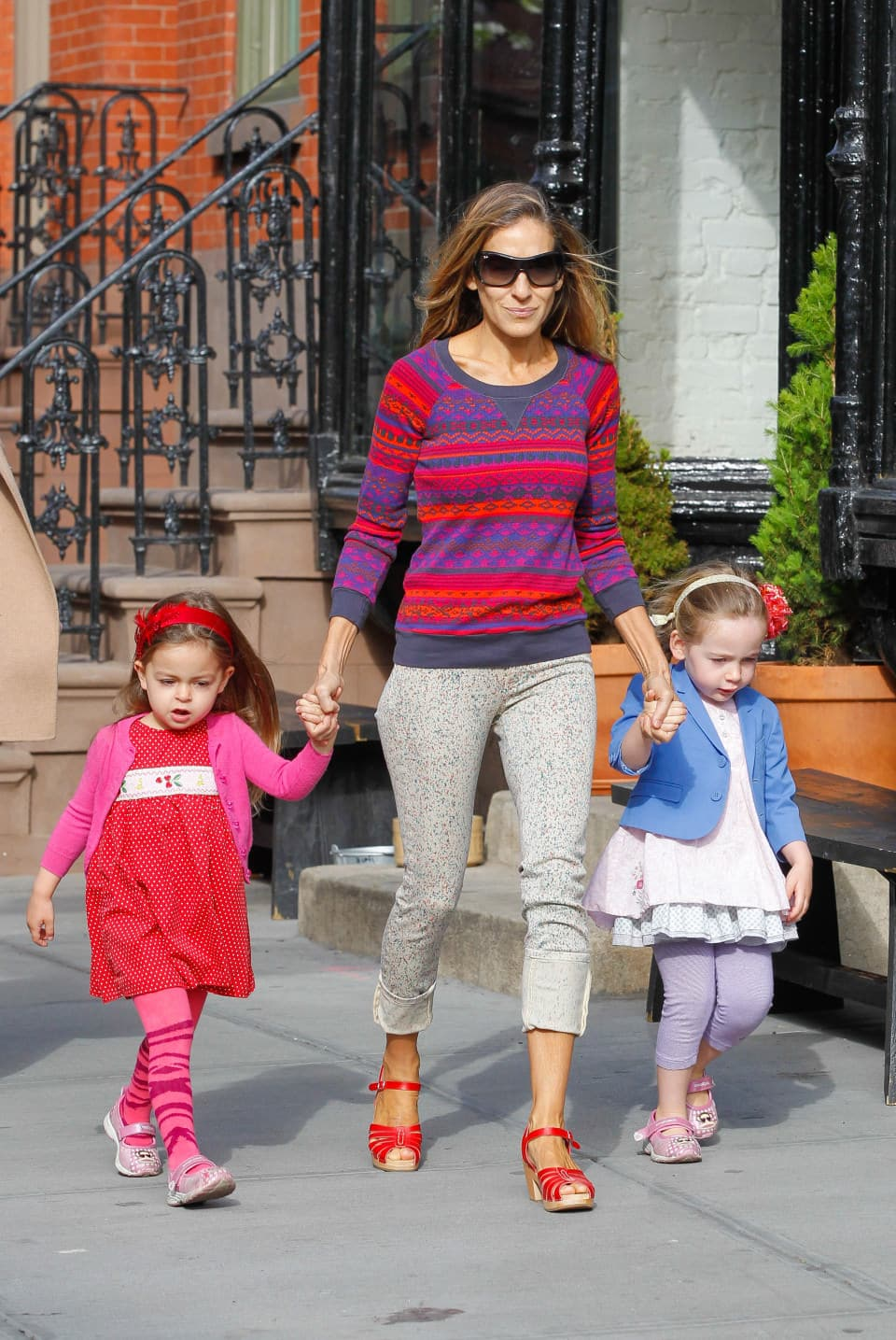 New York, NY - A colorful Sarah Jessica Parker takes the twins to school on a wonderful spring morning.  Sarah watched the girls play and took time to fix Marion's rose head band.  On the way home she stopped to read a political sign at the street. AKM-GSI          April 18, 2013 To License These Photos, Please Contact : Steve Ginsburg (310) 505-8447 (323) 4239397 steve@ginsburgspalyinc.com sales@ginsburgspalyinc.com or Keith Stockwell (310) 261-8649 keith@ginsburgspalyinc.com ginsburgspalyinc@gmail.com