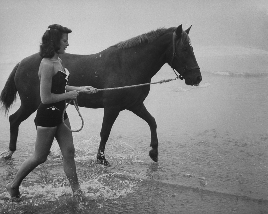 Woman walking the diving horse.  (Photo by Peter Stackpole/The LIFE Picture Collection/Getty Images)