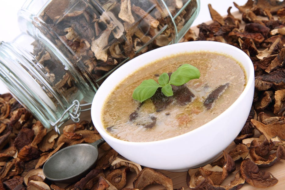 Mushroom soup, dried mushrooms and an antique spoon