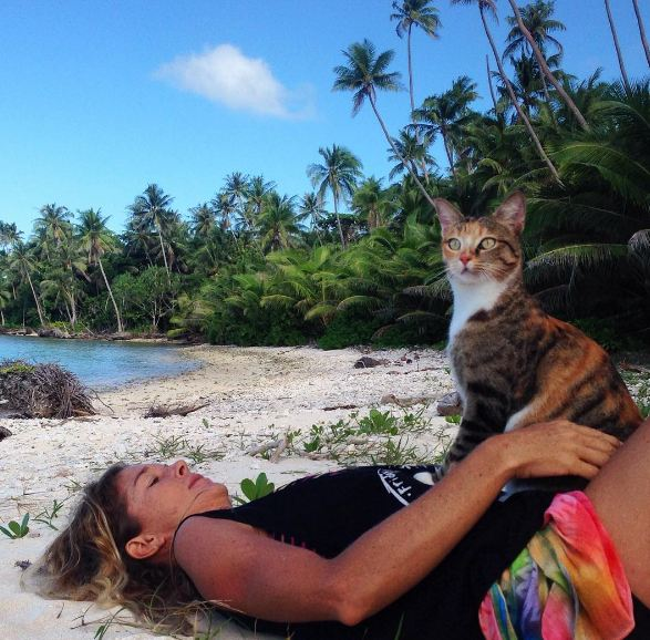 girl with a cat on the beach