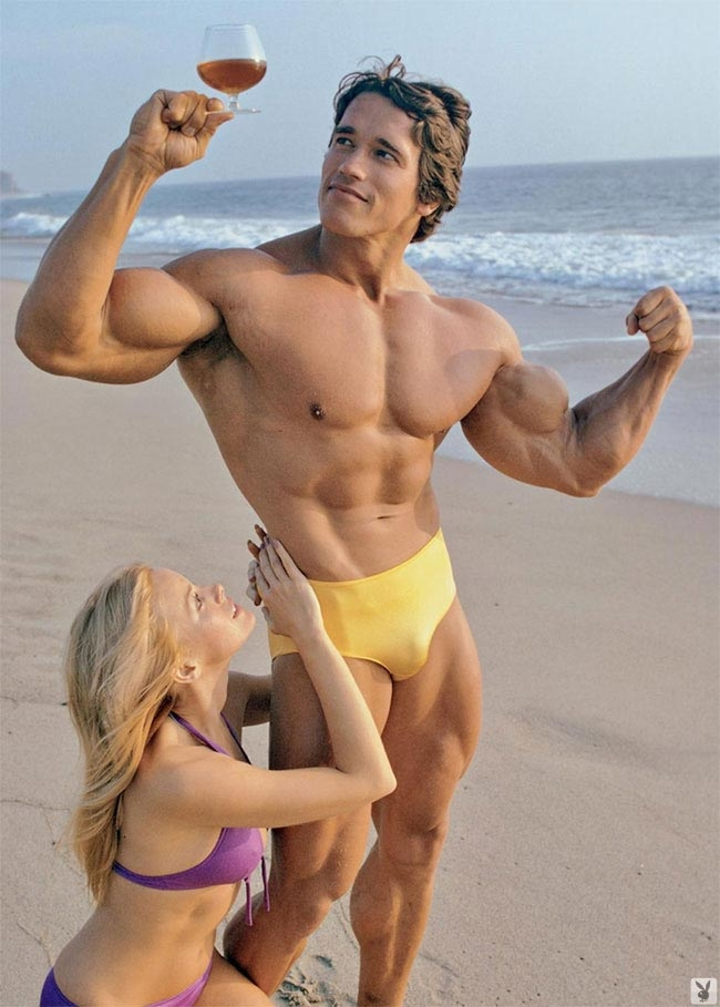 muscular man is punishing tanned lady wearing colorful bikini  346307