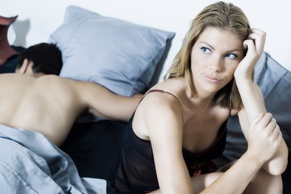 bored-woman-in-bed-with-spouse_osbr3r
